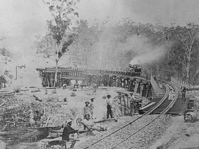 A work train crosses Fitzgibbon's Bridge on the Main Range soon after completion, 1867. Source – Queensland Rail, Queensland Museum